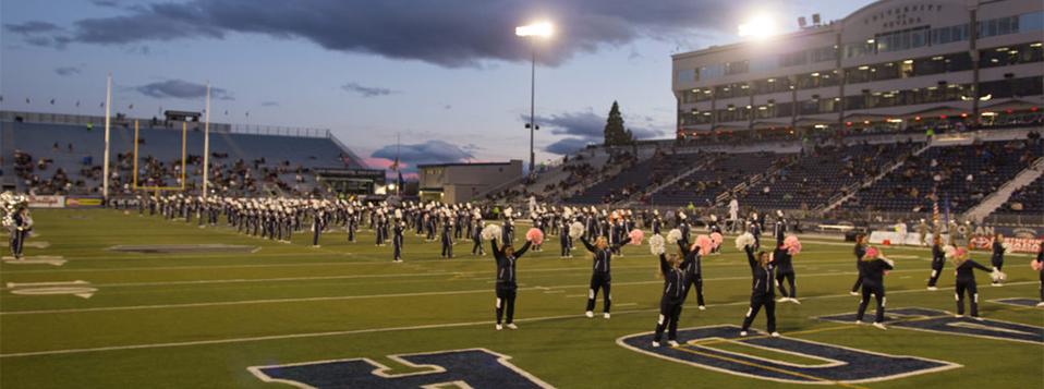 Cheer team at the homecoming game on Mackay Stadium.