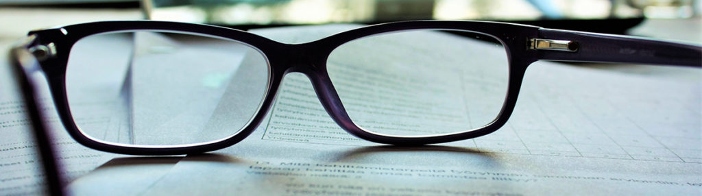 Glasses on top of some documents